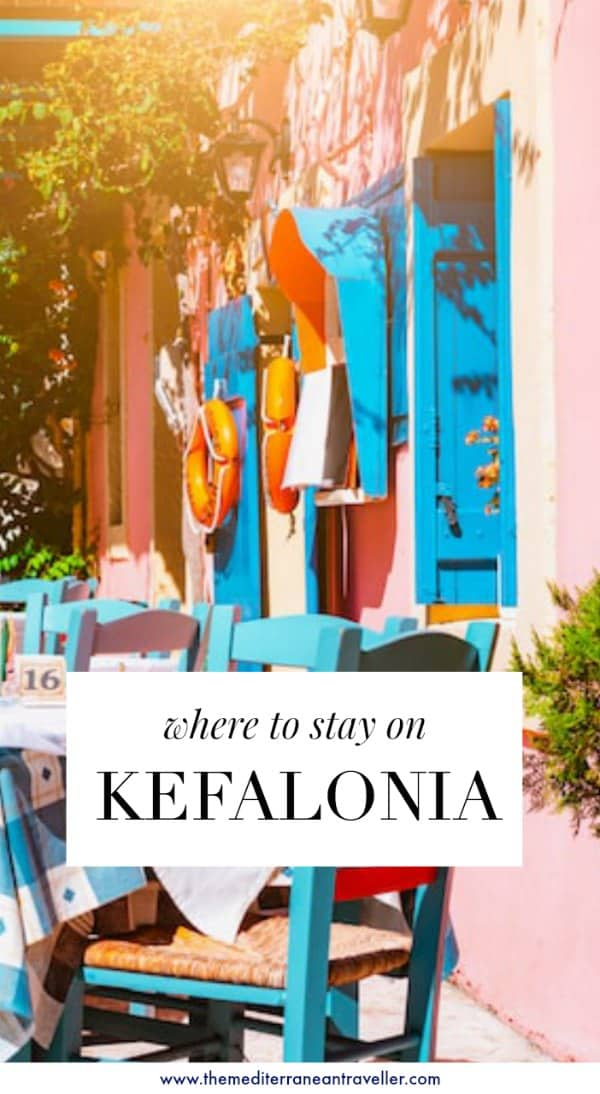 pink taverna in Fiskardo with text overlay 'where to stay on Kefalonia'