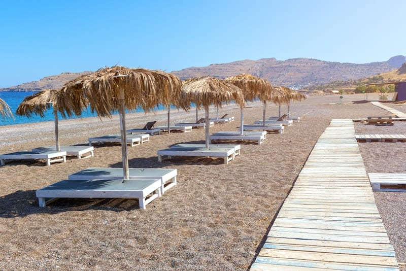 walkway and sun loungers on Kalathos beach
