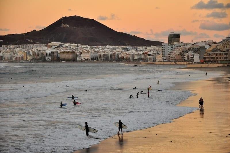 surfers on the beach at Las Palmas de Gran Canaria
