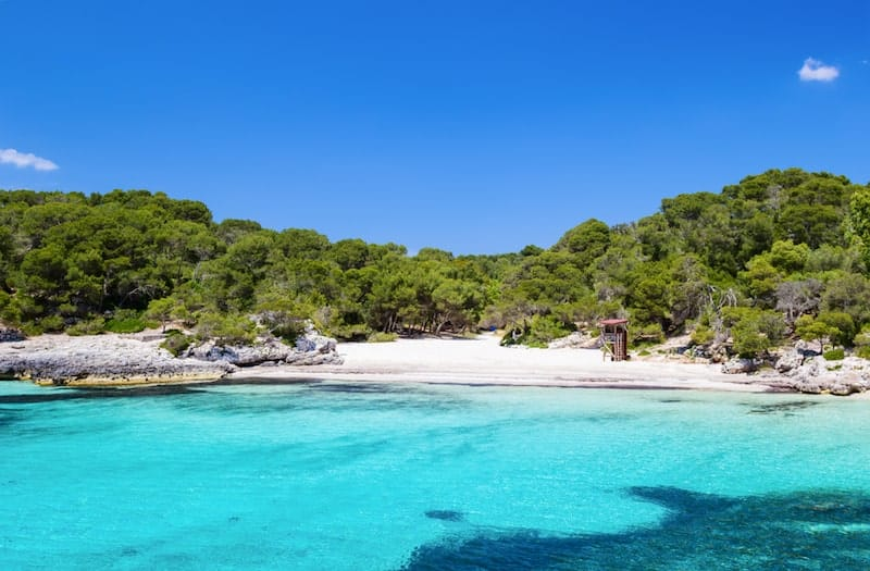 Cala Turqueta's turquoise seas and white sands