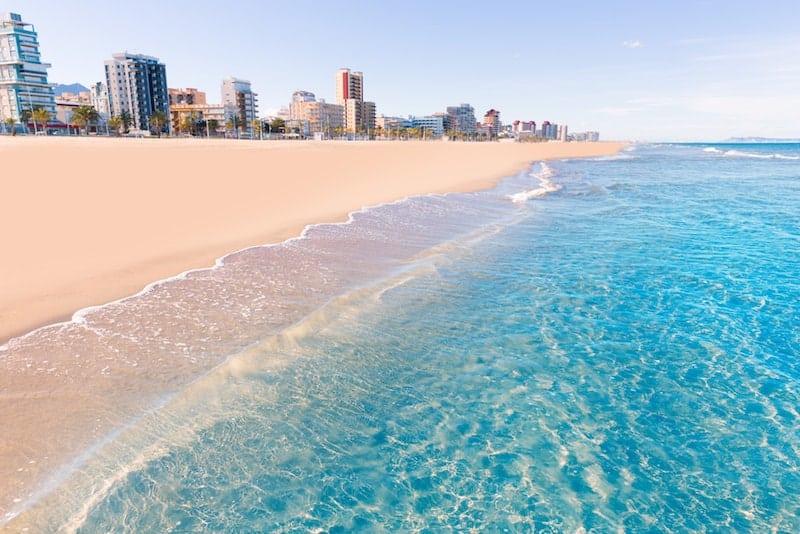 Waves lap Valencia's city beach