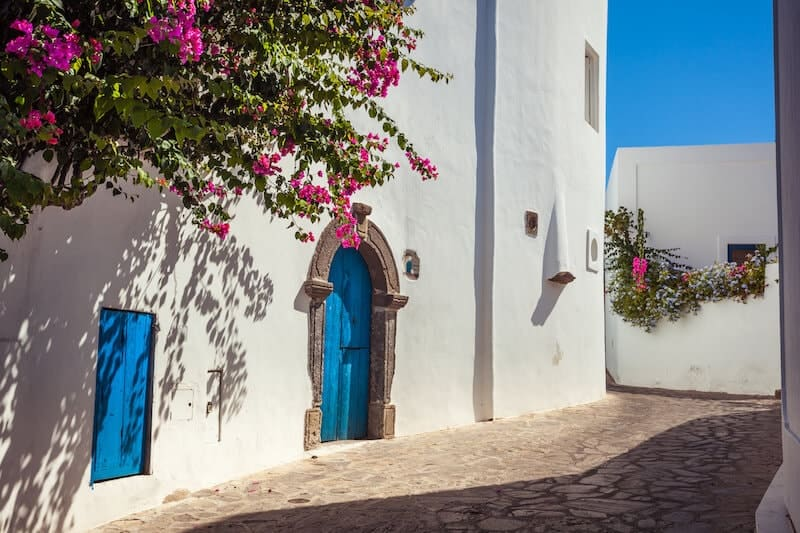 Whitewashed street on Panarea with bougainvillea