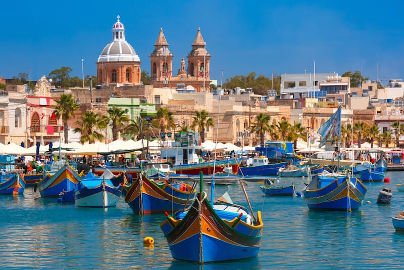 colourful fishing boats moored in harbour at Marsaxlokk
