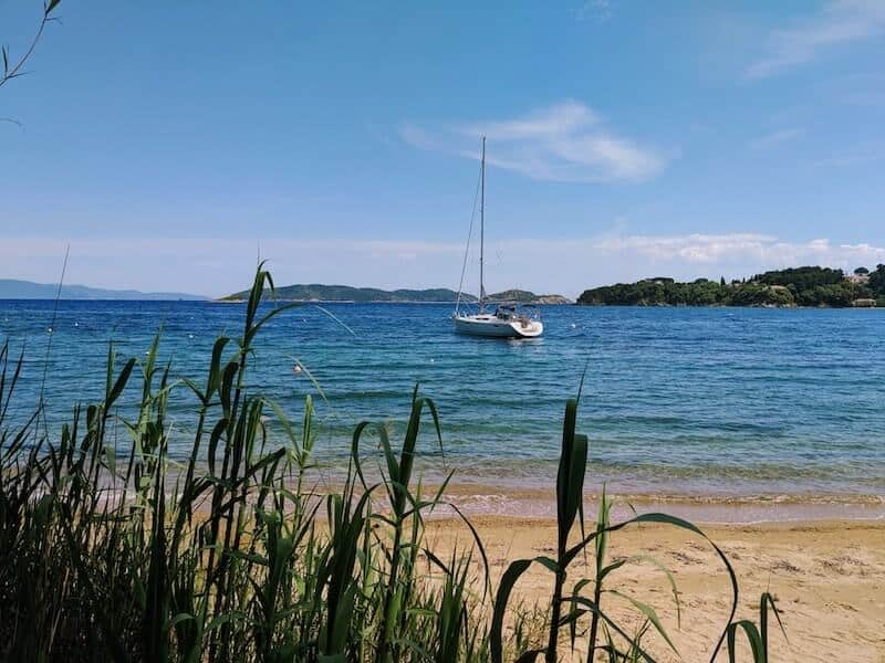 Yacht anchored at Sklithri with tall grasses in foreground