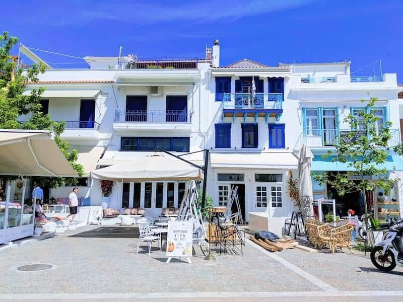 Blue shuttered white buildings at Skiathos Old Port