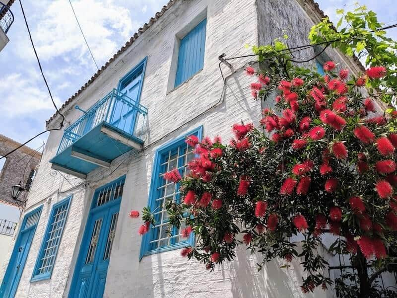 pretty white building with blue woodwork in Skiathos Town