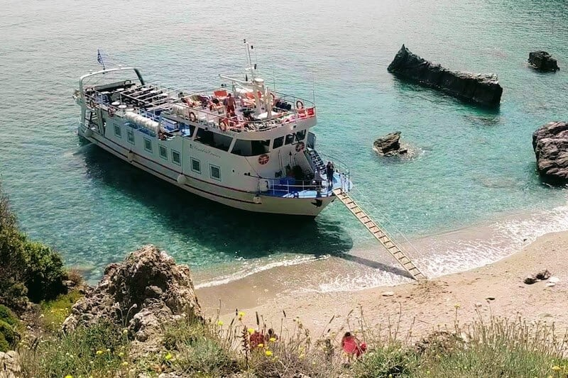 Poseidon boat anchored on Skopelos beach