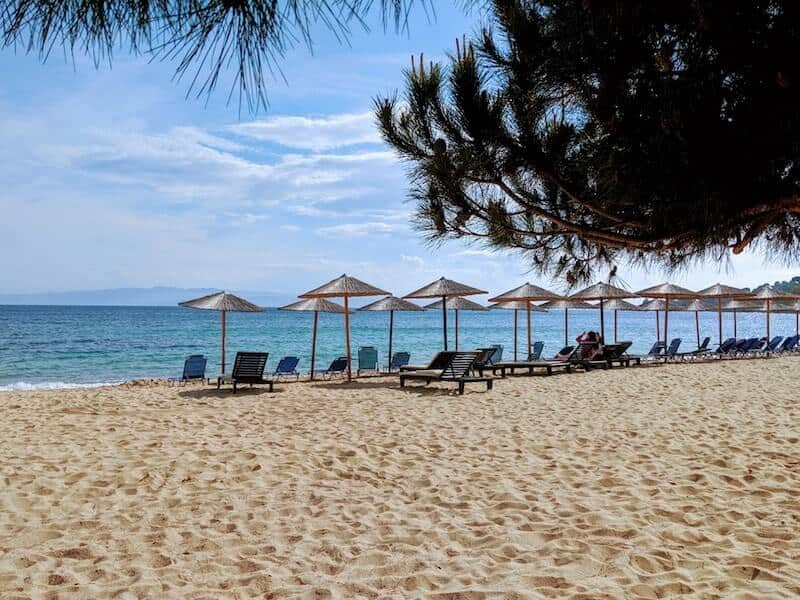 wide sandy Agia Paraskevi beach with loungers