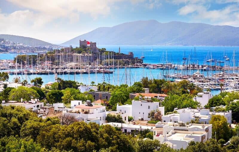 white buildings and marina at Bodrum with castle in the background