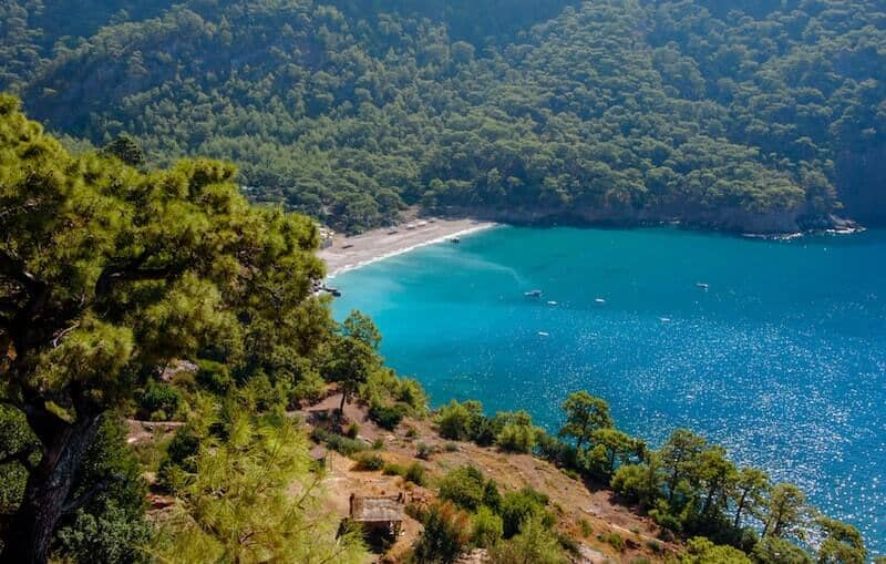 beautiful water surrounded by forest at Kabak Bay
