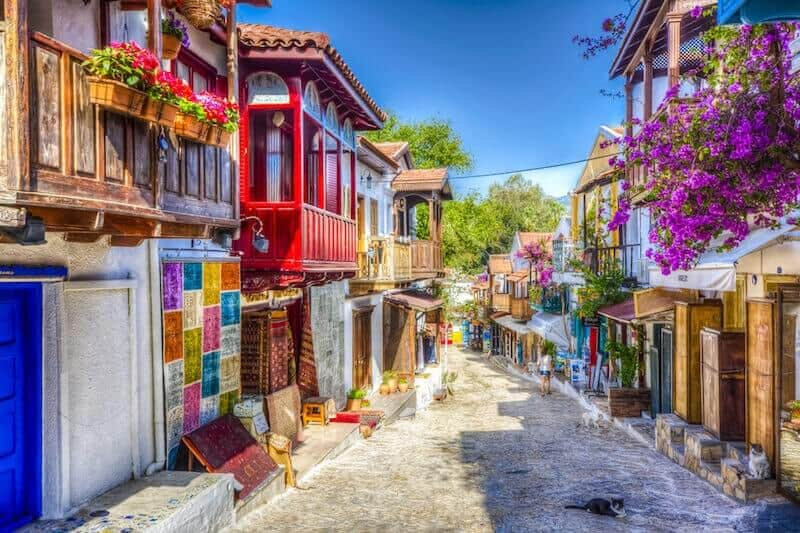 flowers hanging from balconies on a pretty street in Kas