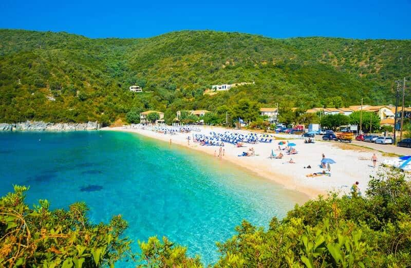 Mikros Gialos beach on Lefkada, surrounded by green hills