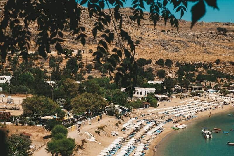 Lindos main beach through the trees