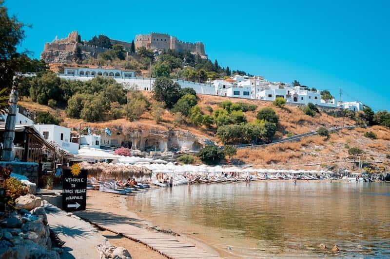 Lindos Yacht Club beach with acropolis behind