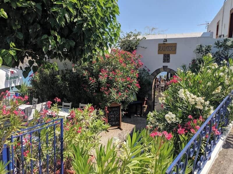 flower-filled cafe in Lindos, Rhodes