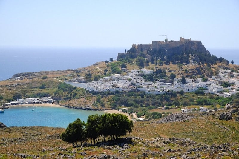 view of Lindos village and acropolis from the main road