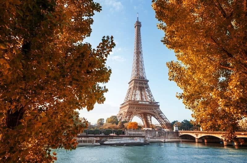 Fall foliage in Paris with the Seine and the Eiffel Tower in the background