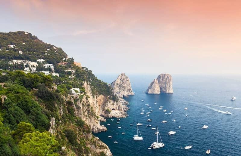 boats surrounding Capri's iconic cliffs