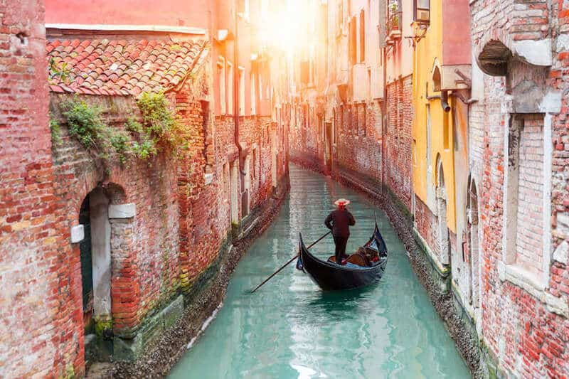 a gondola in one of Venice's narrow canals