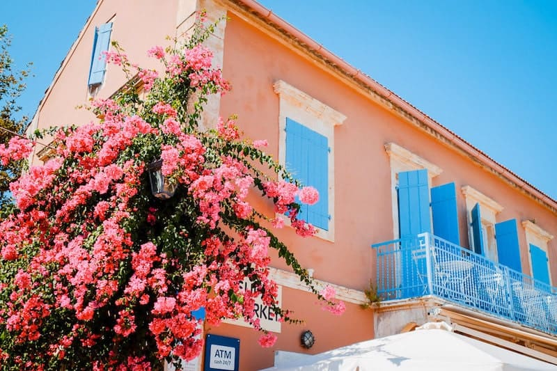 colourful building and flowers in Fiskardo